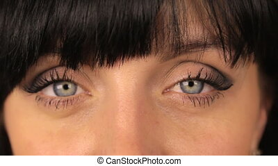 Girl winks with both eyes. makro, close up - Girl winks with...