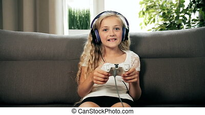 Girl Winning Video Game - Cheerful girl dressed in casual...