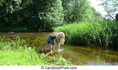 girl wipe palm stream
