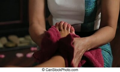 Girl wiped feet with a towel Thai massage