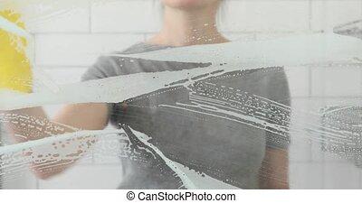 Crop girl wipes dusty glass cloth