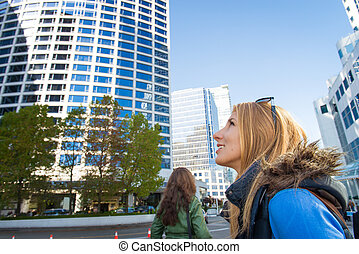 Girl with a backpack in the city