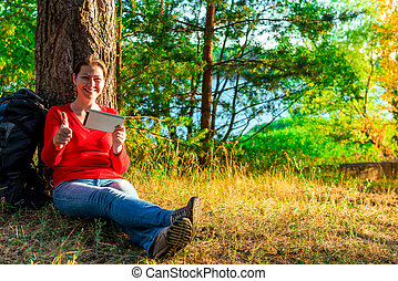 girl with a backpack relaxing in nature