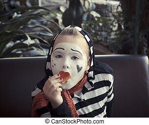 Girl with a balloon in the form of mime actor