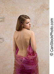 girl with a bare back on a beige background.