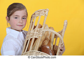 Girl with a basket of baguettes