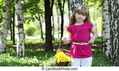 Girl with a basket of tulips