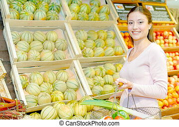girl with a basketful of vegetables