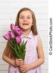 girl with a beautiful bouquet of tulips