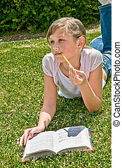 Girl with a book resting in the park