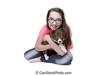 Girl with a border collie puppy dog