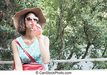 girl with a bottle of water in the open air