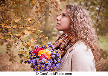 girl with a bouquet of autumn