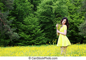 Girl with a bouquet of buttercups