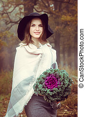 girl with a bouquet of cabbage
