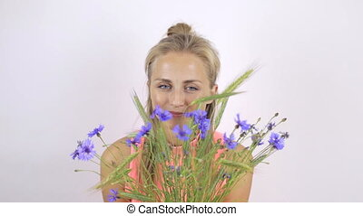 Girl with a bouquet of cornflowers