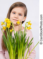 girl with a bouquet of daffodils