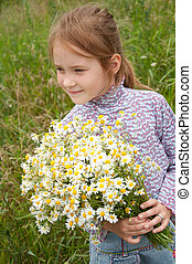 Girl with a bouquet of daisies field