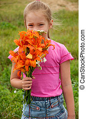 Girl with a bouquet of orange lilies