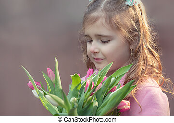 Girl with a bouquet of tulips