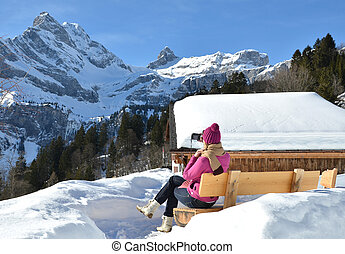 Girl with a camera in Swiss Alps