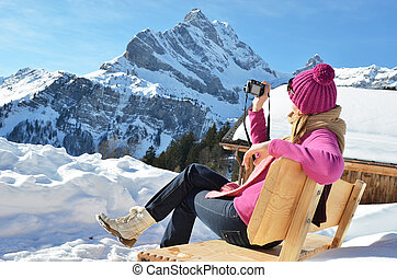 Girl with a camera in the Swiss Alps