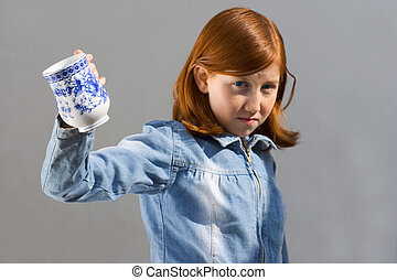 Girl with a cup (Focus on cup)
