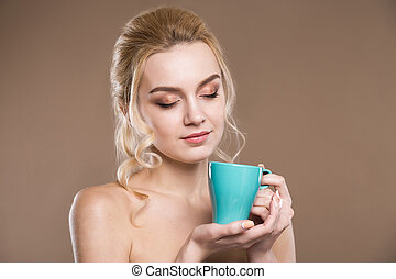 Girl with a cup in his hands