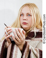 girl with a cup wrapped in a blanket. white background