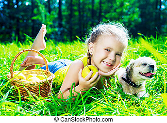 girl with a dog outdoor - happy girl with a dog having a...