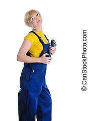 girl with a drill in building overalls