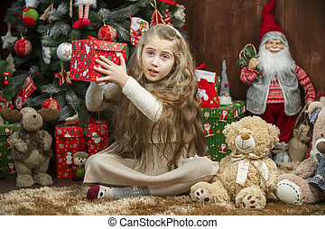 Girl with a gift box in her hands