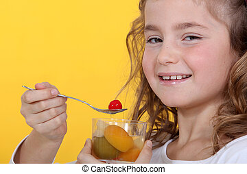 Girl with a glass of fruit salad