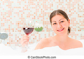 girl with a glass of wine in the foam