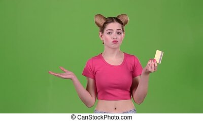 Girl with a gold card upset she does not have money. Green screen