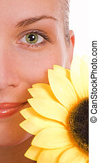 Girl with a green eyes and sunflower
