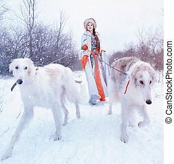 girl with a Greyhound in winter