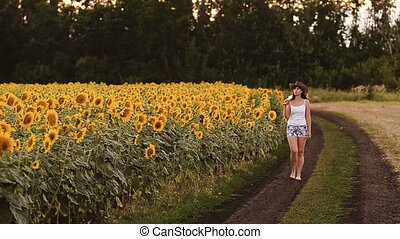 Girl with a guitar in sunflowers.