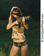 Girl with a gun for trap shooting and shooting glasses ...