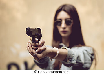girl with a gun on the street learns to shoot