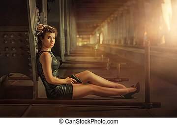 Girl with a gun. - Girl with two pistols sitting on a metal...