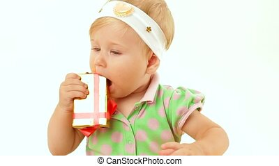 Girl With A Holiday Gift - Small child chews festively...