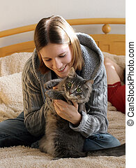 Girl with a kitten - Happy girl playing with her kitten