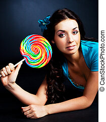 girl with a lollipop - pretty smiling brunette girl with a...