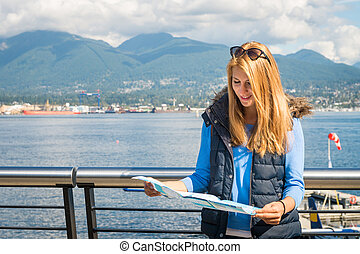Girl with a map in the city