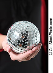 girl with a mirror ball in her hand