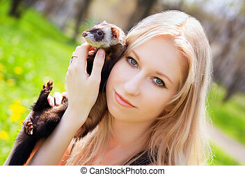 Girl with a polecat - Portrait of the girl with a domestic...