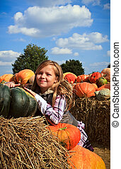 Girl with a pumpkins