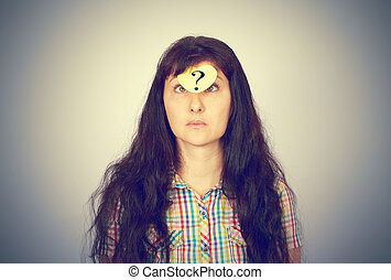girl with a question mark over her forehead