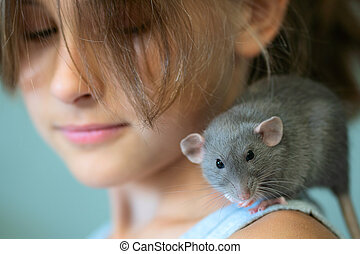 Girl with a rat on his shoulder. Favorite pet.